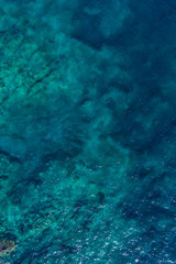 Aerial view on green waves, seabed texture