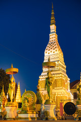 The beautiful pagoda and buddha statue at public temple in Thailand on twilight moment