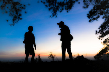 silhouette of the man is talking with the woman