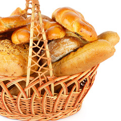 Bread and baked goods in a wicker basket isolated on a white background