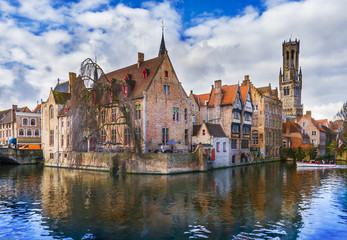 Wall Mural - Famous Belfry tower and medieval buildings along a canal in Bruges, Belgium