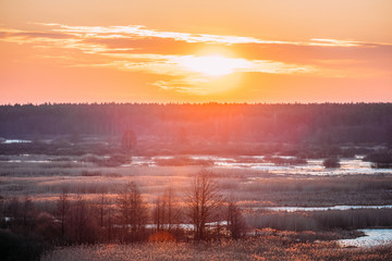 Beautiful Sunrise Over Forest And River In Early Spring. Dramatic Sky