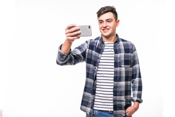 Close up portrait of a cheerful man taking selfie over white background