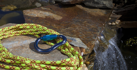Climbing rope and carabiner next to water
