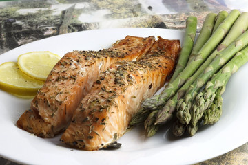 Fried salmon fillets with asparagus on a plate