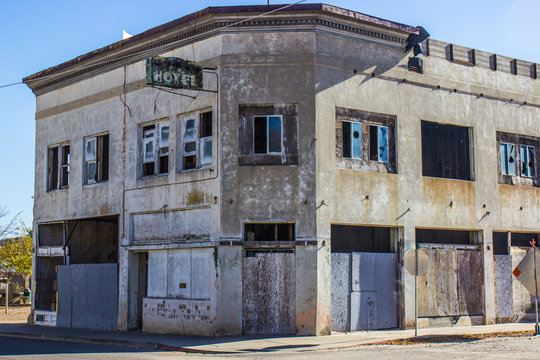 Abandoned Commercial Building With Boarded Up Doors