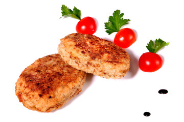 Two cutlets with cherry tomatoes and parsley