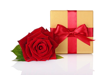 Golden classic gift box with red satin bow and beautiful rose