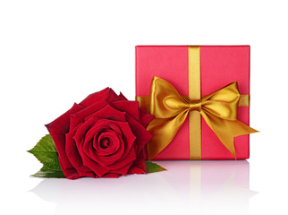 Red classic gift box with golden satin bow and beautiful rose