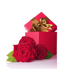 Red classic gift box with brown satin bow and bouquet of roses