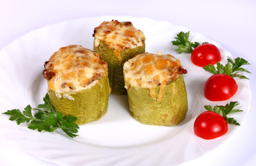 Baked zucchini filled with vegetables