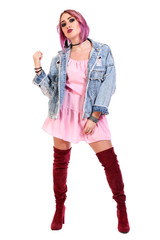 Young woman with a purple hair in a pink dress and jeans jacket