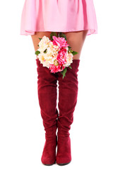 Woman legs with a bunch of flowers