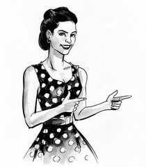 Pretty pin up girl in polka dots dress, pointing to the right
