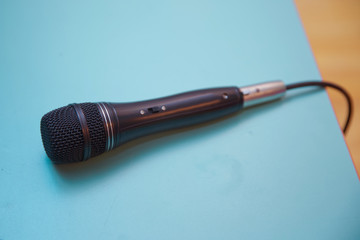 Microphone in the blue background . A microphone isolated on a sky background clipping path . Abstract soft blurred and soft focus of microphone with the blue sky and copy space background .