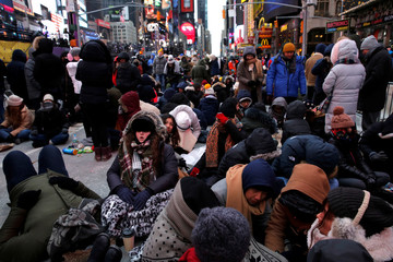 Revelers gather in Times Square as a cold weather front hits the region ahead of New Year's celebrations in Manhattan, New York