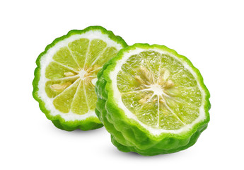 half cut slice of fresh bergamot isolated on white background
