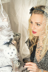 Young beautiful woman on Christmas decoration