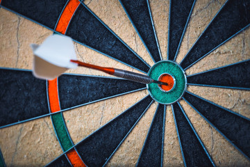 close up of the darts in bulls eye