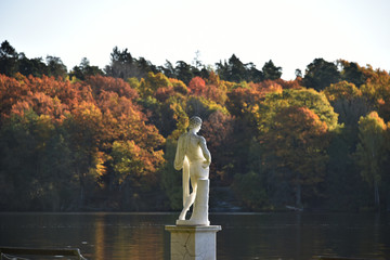 Statue in morning sun at autumn