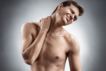 Man suffering from neck pain. Medical concept.