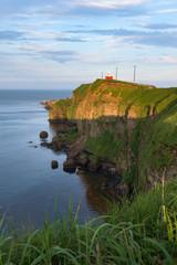 Kiritappu cape lighthouse on the rocky cliffs after sunset, Hokkaido, Japan