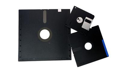 Old storage diskette floppy disk on white background