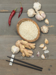rice and garlic on a wooden table.