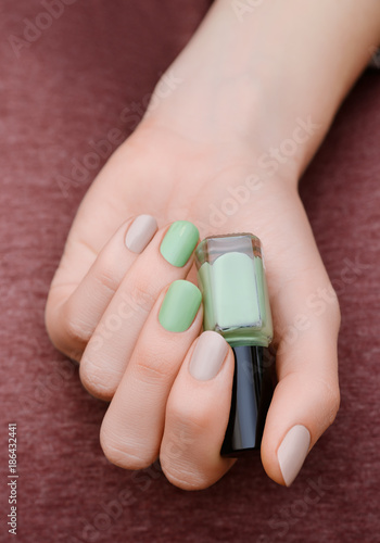 Beautiful Female Hand With Light Green Nail Design Stock Photo And