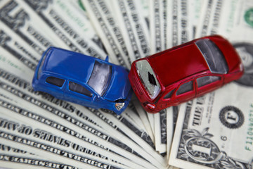 concept of car insurance, imitation collision, amid American banknotes, car accident