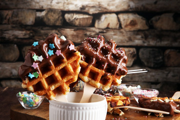 Wall Mural - Belgium waffles with chocolate sauce. popsicles with chocolate and wafer.