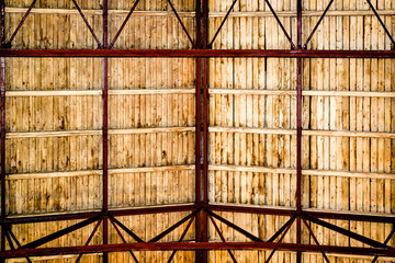Wooden roof, visible red rafters and light brown laths