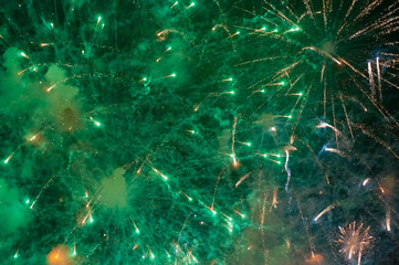 Stunning bright vibrant and colorful fireworks in the night sky during new year celebrations