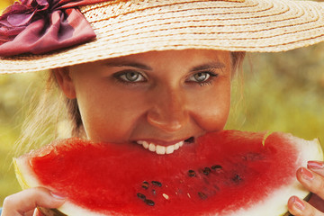 Beautiful happy young woman eating watermelon. Vitamins, nutritional vegetarian food, holiday, diet concept.