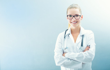 Young doctor woman smile face with stethoscope and white coat