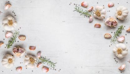Garlic. Garlic bulbs. Fresh garlic with rosemary and pepper on w