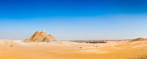 Panorama of the desert with the great pyramids of Giza, Egypt