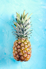 Pineapple fruit over blue background