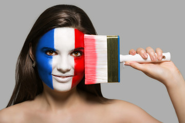 The face of a woman in the national colors of France