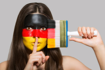 The face of a woman in the national colors of Germany