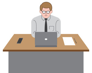 A young worker is at his desk in his office using his laptop