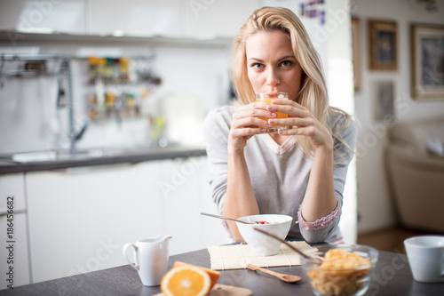 Beautiful Blond Caucasian Woman Posing In Her Kitchen While