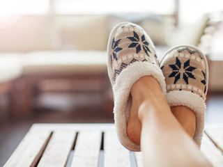Slippers on women's legs