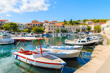 Fototapete - Colorful typical fishing boats anchoring in Sumartin port on Brac island, Croatia