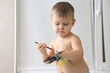 little boy paints paint your hand