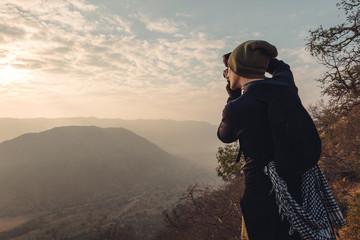 Man take a photo in mountains