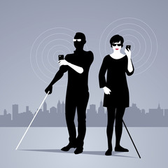 Mobile Technology for People with Visual Impairments. Couple of blind people using smartphones with adapted technology