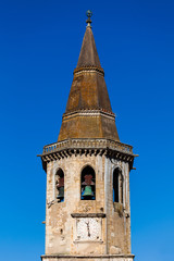 Clock tower of the Church of St. John the Baptist in Tomar, Portugal