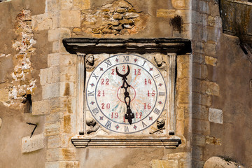 Closeup on the clock face on the 16th-century clock tower of the Church of St. John the Baptist in Tomar, Portugal