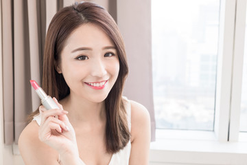 woman take lipstick in home